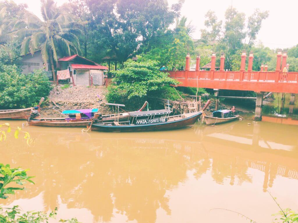 Moored Boats on a River in Thailand   Go to Thailand