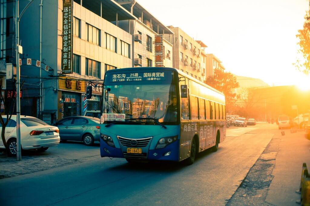 Blue Bus at sunset | Affordable Transportation